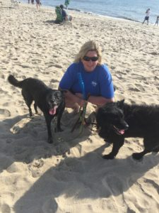 Deb and happy dogs on beach